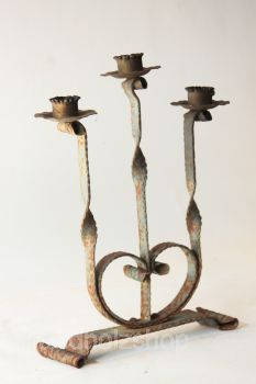 Antique iron candle holder