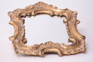 Hand-carved frame gilded with mirror ornamental mirror